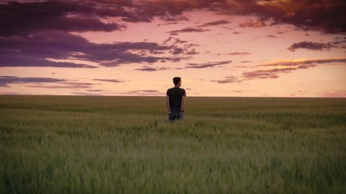 A person walking in a field.