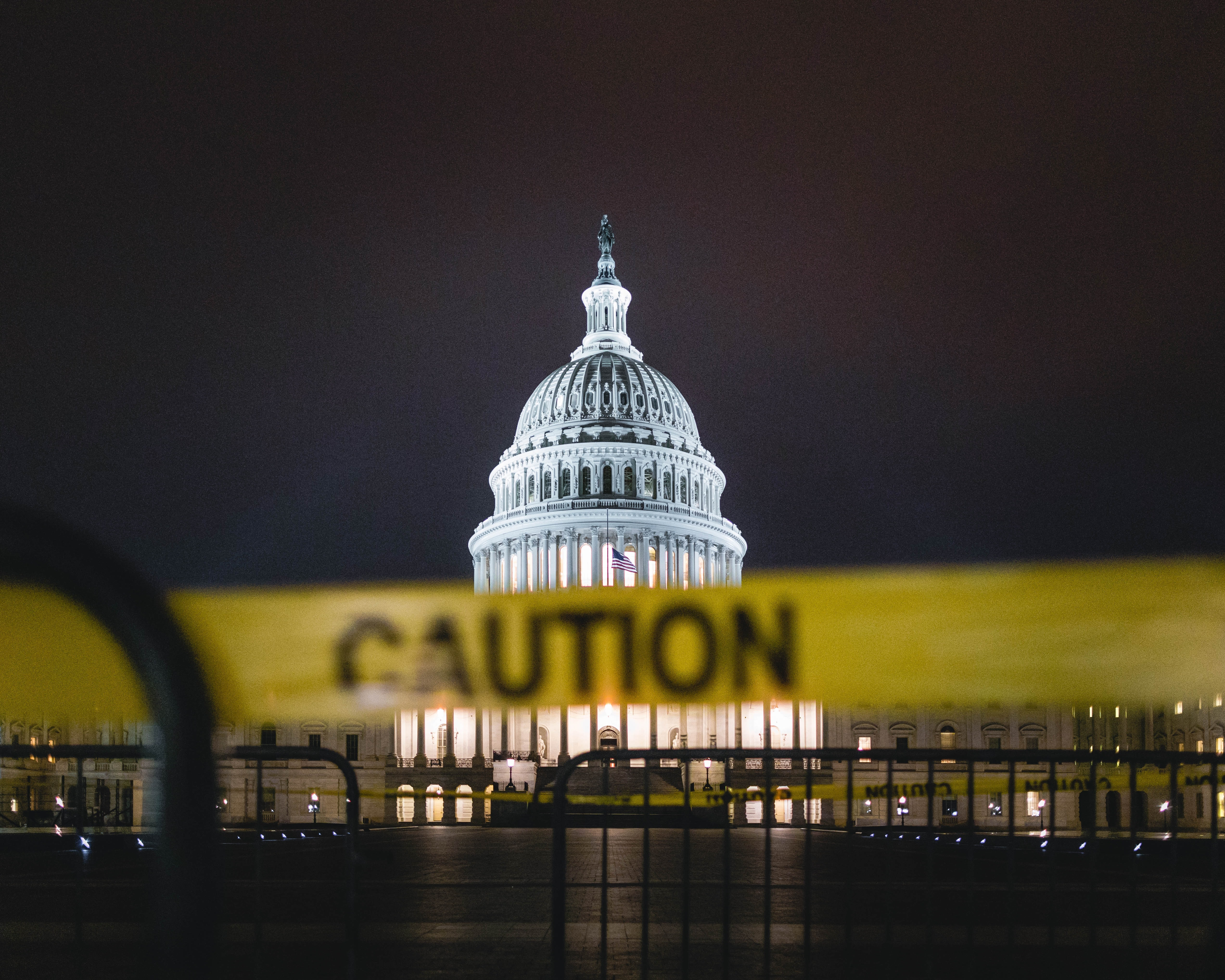 Photo of the U.S. Capitol in the background with caution tape in the foreground.